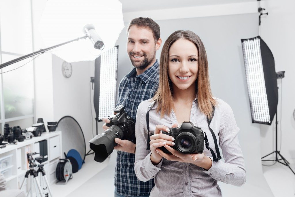 Photographers in a studio with lights