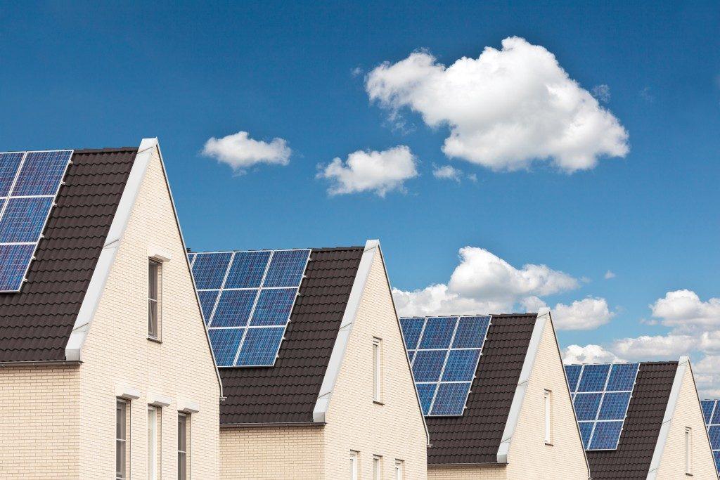 row of houses using solar panels